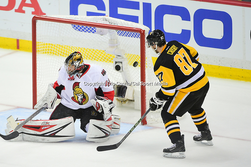 May 21, 2017: Pittsburgh Penguins center Sidney Crosby (87) watches as the puck gets by Ottawa Senators goalie Craig Anderson (41) during game five of the National Hockey League Eastern Conference Finals between the Ottawa Senators and the Pittsburgh Penguins, held at PPG Paints Arena, in Pittsburgh, PA. Pittsburgh shuts out Ottawa 7-0 to lead the series 3-2.  Eric Canha/CSM
