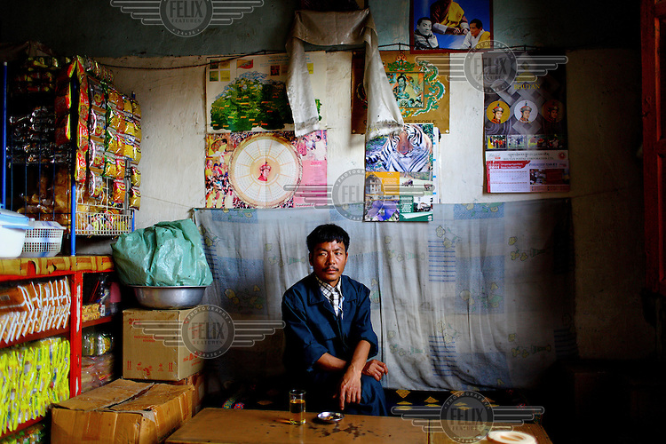 A man has a drink in his local restaurant in Thimpu.