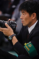 A police photographer at the 59th All Kendo Championship,  Budokan, Tokyo, Japan, November 3, 2011. Contestants from all over Japan compete doing the day-long event. Kendo is a popular martial art based on traditional Japanese swordsmanship.