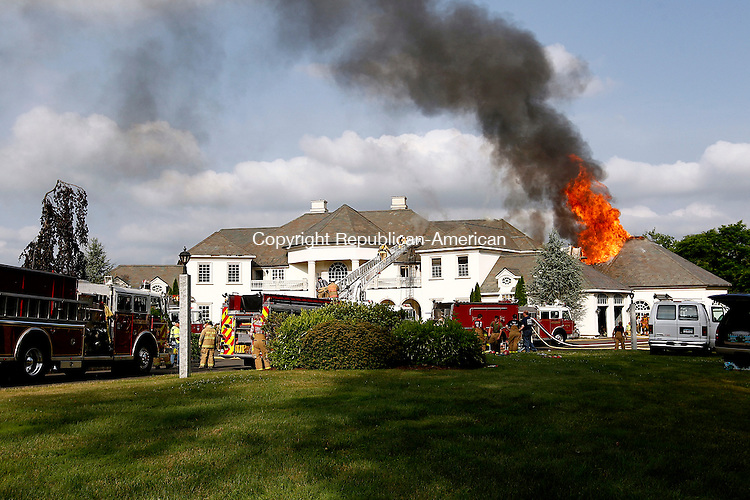Middlebury, CT- 03 July 2014-070314CM04-  Firefighters battle a house fire at 725 Breakneck Hill Rd in Middlebury on Thursday.  Firefighters from Middlebury, Southbury, Watertown and Waterbury responded to fight the blaze.   Christopher Massa Republican-American