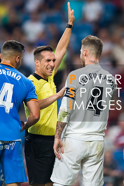 Referee Xavier Estrada Fernandez talks to Sergio Ramos of Real Madrid during the La Liga 2018-19 match between Real Madrid and Getafe CF at Estadio Santiago Bernabeu on August 19 2018 in Madrid, Spain. Photo by Diego Souto / Power Sport Images
