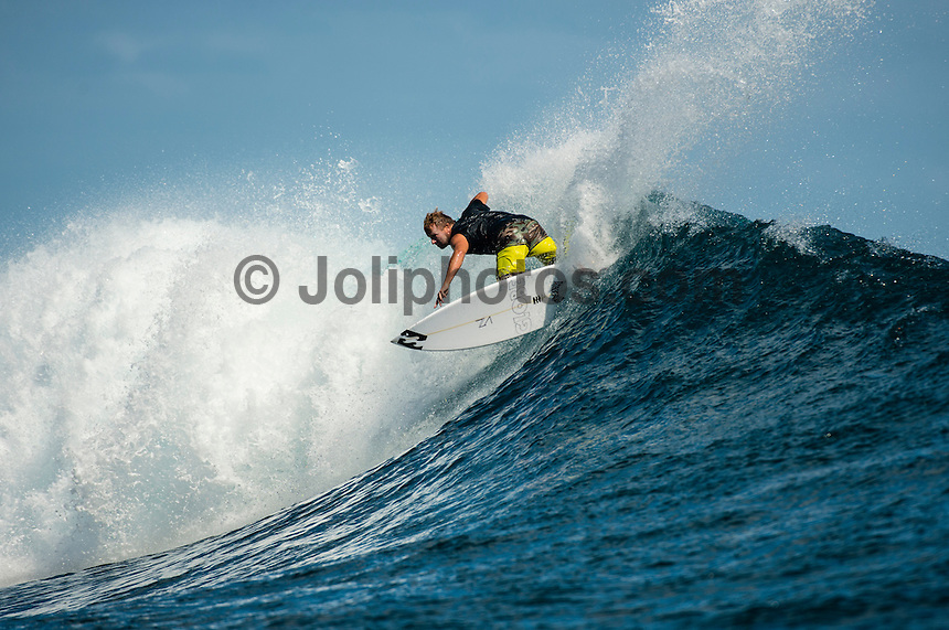 CLOUDBREAK, Namotu Island/Fiji (Monday, June 10, 2013) Taj Burrow (AUS)  free surfing while waiting for the call.- After checking conditions at Cloudbreak  this morning, event officials at the Volcom Fiji Pro put the contest on hold a number of times through the day. The last call was made at 2 pm before it was called off for the day. <br /> Stop No. 4 of 10 on the ASP World Championship Tour (WCT), the Volcom Fiji Pro has enjoyed flawless conditions at both Cloudbreak and Restaurants and the current forecast is showing signs of more excellent surf to come.<br /> Photo: joliphotos.com