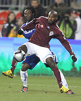 Ugo Ihemelu#3 of FC Dallas pushes into the back of Omar Cummings#14 of the Colorado Rapids during MLS Cup 2010 at BMO Stadium in Toronto, Ontario on November 21 2010. Colorado won 2-1 in overtime.