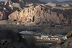 November 2012, Bamiyan, Afghanistan: A view of the empty Buddhas of Bamiyan niches, two 6th century monumental statues of standing buddha carved into the side of a cliff in the Bamyan valley in the Hazarajat region of central Afghanistan.The valley is home to many Hazara's, who have often made up vast numbers of refugees to Australia, having been persecuted and driven from their homes in both Afghanistan as well as from Quetta in Pakistan where a lot of displaced Hazara fled to during the Taliban years. Bamiyan is home to a lot of Hazara who are Shia muslim and as such are looked down upon by the Sunni Pashto tribes that make up the population majority in Afghanistan.   Picture by Graham Crouch/The Australian Magazine.