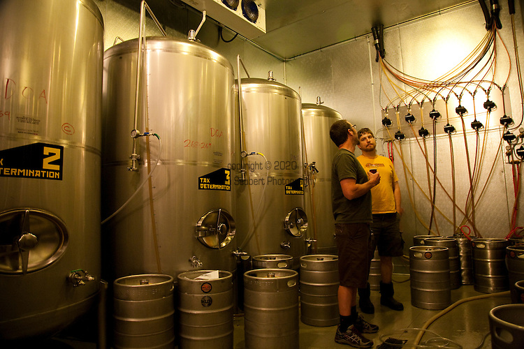 Hopworks Urban Brewery located in Southeast Portland is Portland's first Eco-Brewpub and offers all organic handcrafted beers, fresh local ingredients used for its menu items and located in a refurbished, sustainable building.  Pictured is owner/brewmaster Christian Ettinger in the brewery which is located downstairs from the restaurant.