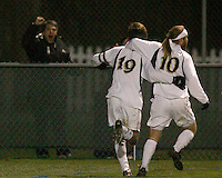 Alex Yoshinaga #19 celebrates after scoring the first goal for Notre Dame assisted by Joseph Lapira #10. The University of Notre Dame defeated Oakland University 2-1 in the second round of the NCAA championship at Alumni Field at the University of Notre Dame in South Bend, Indiana on November 28, 2007.