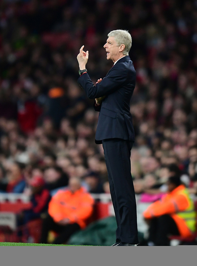 Arsenal manager Arsene Wenger shouts instructions to his team from the dug-out<br /> <br /> Photographer Chris Vaughan/CameraSport<br /> <br /> The Emirates FA Cup Quarter-Final - Arsenal v Lincoln City - Saturday 11th March 2017 - The Emirates - London<br />  <br /> World Copyright &copy; 2017 CameraSport. All rights reserved. 43 Linden Ave. Countesthorpe. Leicester. England. LE8 5PG - Tel: +44 (0) 116 277 4147 - admin@camerasport.com - www.camerasport.com