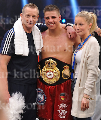 November 05-16,MBS Arena, Potsdam, Brandenburg, Germany<br /> WBA World super middleweight title<br /> Super Middleweight	 Champ from Italy,Giovanni De Carolis vs Tyron Zeuge,Berlin,Germany<br /> Zeuge wins by twelfth round TKO ,gets belt l-r: his coach Conny Mittermeier and his girlfriend