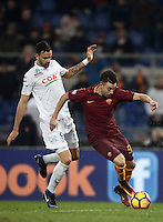 Calcio, Serie A: Roma vs ChievoVerona. Roma, stadio Olimpico, 22 settembre 2016.<br /> Roma&rsquo;s Stephan El Shaarawy, right, is challenged by Chievo Verona's Ivan Radovanovic during the Italian Serie A football match between Roma and Chievo Verona, at Rome's Olympic stadium, 22 December 2016.<br /> UPDATE IMAGES PRESS/Isabella Bonotto