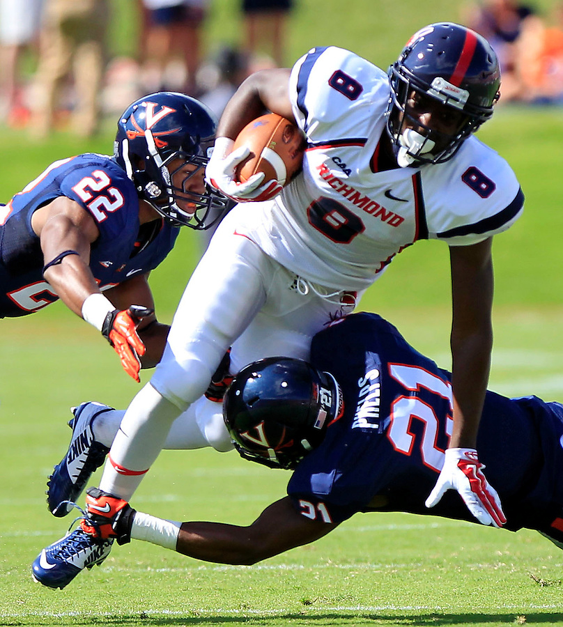Richmond wide receiver Rashad Ponder (8) is tackled by Virginia safety Brandon Phelps (21) and cornerback DreQuan Hoskey (22)during the game Saturday Sept. 6, 2014 at Scott Stadium in Charlottesville, VA. Virginia defeated Richmond 45-13. Photo/Andrew Shurtleff