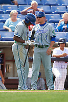 Hartford Yard Goats coach Jake Opitz (4) talks with Luis Jean (17) during a game against the Binghamton Rumble Ponies on July 9, 2017 at NYSEG Stadium in Binghamton, New York.  Hartford defeated Binghamton 7-3.  (Mike Janes/Four Seam Images)