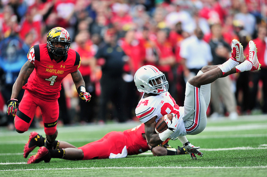 Corey Smith of the Buckeyes' is upended by the Terrapins' defense. Ohio State trounced Maryland 52-24 during a game at the Capital One Field in Byrd Stadium, College Park, MD on Saturday, October 3, 2014.  Alan P. Santos/DC Sports Box