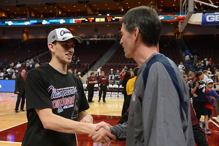 March 11, 2014; Las Vegas, NV, USA; Gonzaga Bulldogs guard David Stockton (11, left) shakes hands with father John Stockton (right) against the Brigham Young Cougars after the game of the WCC Basketball Championships at Orleans Arena.