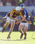 Cillian Brennan of Ballyea in action against Diarmuid Ryan of  Cratloe during the county senior hurling final at Cusack Park. Photograph by John Kelly.