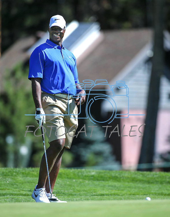 Former MLB player Fred McGriff plays in an American Century Championship practice round at Edgewood Tahoe Golf Course in Stateline, Nev., on Wednesday, July 15, 2015. <br /> Photo by Cathleen Allison