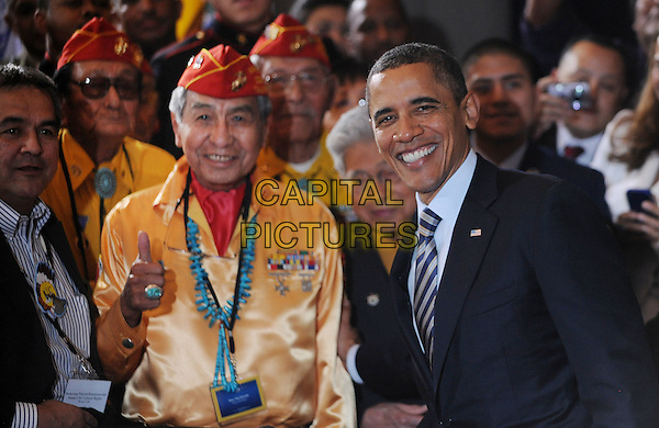 President Barack Obama poses with Navajo Code Talkers and former U.S. Marines .after speaking at the White House Tribal Nations Conference at the U.S. Department of the Interior, Washington, DC, USA, December 2nd 2011..politics american america half length smiling suit tie thumb up gesture .CAP/ADM/OD.©Olivier Douliery/Pool/CNP/AdMedia/Capital Pictures..