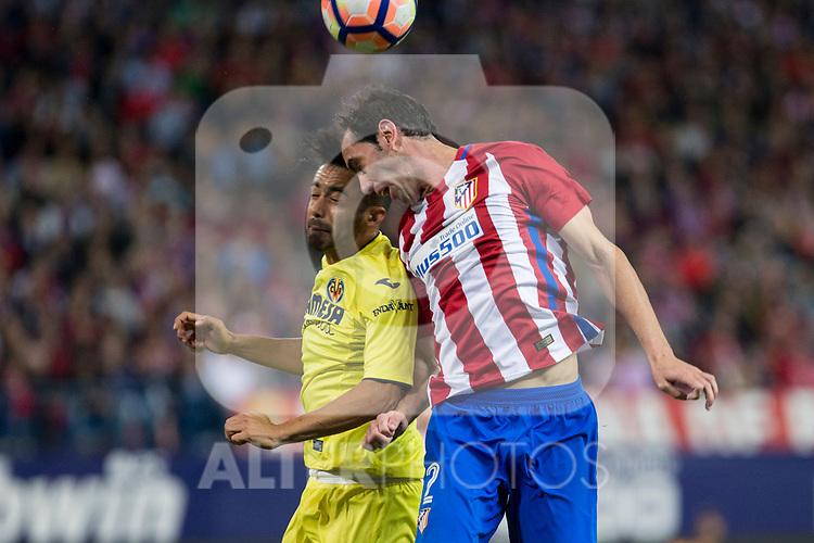 Cedric Bakambu of Villarreal battles for an aerial ball Diego Godin of Atletico de Madridduring the match of La Liga between Atletico de Madrid and Villarreal at Vicente Calderon  Stadium  in Madrid, Spain. April 25, 2017. (ALTERPHOTOS/Rodrigo Jimenez)