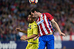 Cedric Bakambu of Villarreal battles for an aerial ball Diego Godin of Atletico de Madridduring the match of La Liga between Atletico de Madrid and Villarreal at Vicente Calderon  Stadium  in Madrid, Spain. April 25, 2017. (ALTERPHOTOS/Rodrigo Jimenez)