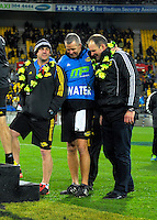 The three assistant coaches, Jason Holland, Richard watt and John Plumtree, wait to recieve their tankards after the Super Rugby final match between the Hurricanes and Lions at Westpac Stadium, Wellington, New Zealand on Saturday, 6 August 2016. Photo: Dave Lintott / lintottphoto.co.nz