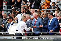 Ex Arsenal goalkeeper, Bob Wilson, presents Arsenal Manager, Arsene Wenger with his Community Shield Winners medal during Arsenal vs Chelsea, FA Community Shield Football at Wembley Stadium on 6th August 2017