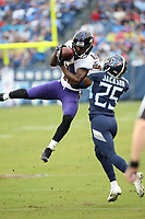 Baltimore Ravens WR John Brown #13 makes a catch in front of Tennessee Titan's S Adore Jackson #25 during an NFL football game between the Baltimore Ravens and the Tennessee Titans, Sunday, Oct. 14, 2018 in Nashville, Tenn. (Photo by Michael Zito/AP Images for Panini)