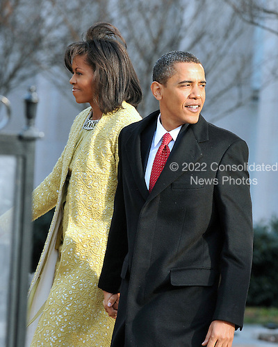Washington, DC - January 20, 2009 -- United States President-elect Barack Obama and Michelle Obama depart St. John's Church in Washongton, D.C. on Tuesday, January 20, 2009..Credit: Ron Sachs - Pool via CNP