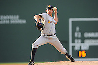 Starting pitcher Caleb Smith (12) of the Charleston RiverDogs in a game against the Greenville Drive on Wednesday, June 11, 2014, at Fluor Field at the West End in Greenville, South Carolina. Greenville won, 6-3. (Tom Priddy/Four Seam Images)