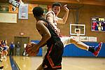 La Salle Prep guard Luke Kolln (20) jumps towards Gladstone guard Handsome Smith (11) in the first half at La Salle High School.<br /> Photo by Jaime Valdez
