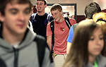 Kevin Whitaker laughs with his friends between classes at Leslie County High School in Hyden, Ky. on Thursday, October 10, 2013. Photo by Adam Pennavaria