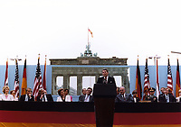 Ronald Reagan speaking in front of the Brandenburg Gate and the Berlin Wall on June 12, 1987.<br /> <br /> PHOTO : White House Photographic Office