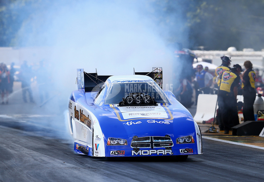 Aug. 16, 2013; Brainerd, MN, USA: NHRA funny car driver Jack Beckman during qualifying for the Lucas Oil Nationals at Brainerd International Raceway. Mandatory Credit: Mark J. Rebilas-