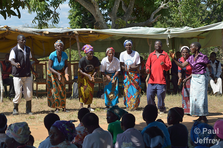 Villagers present a play as part of an education program promoting proper prenatal care and maternal health in Kayeleka Banda, Malawi. The villagers get support from the Maternal, Newborn and Child Health program of the Livingstonia Synod of the Church of Central Africa Presbyterian.