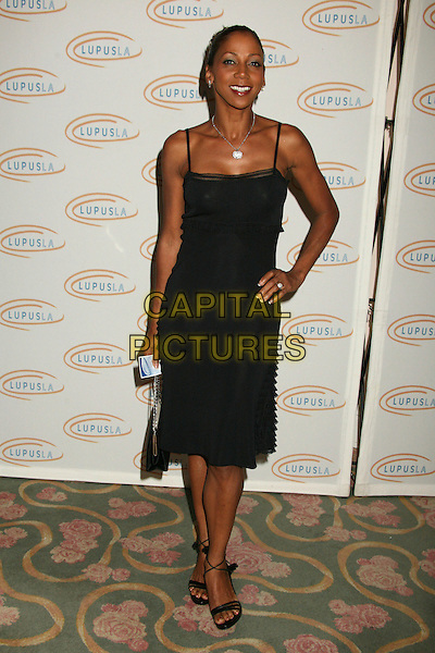 """HOLLY ROBINSON PEETE.Lupus LA's """"Love, Light and Laughter"""" Fundraiser 2007 at the Beverly Hills Hotel, Beverly Hills, California, USA..May 8th, 2007.full length black dress hand on hip .CAP/ADM/BP.©Byron Purvis/AdMedia/Capital Pictures"""
