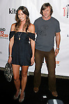 Actress Liz Carey and actor Jake Weber arrive at the launch of Camila Alves' Handbag Collection MUXO at Kitson Studio on August 7, 2008 in Los Angeles, California.