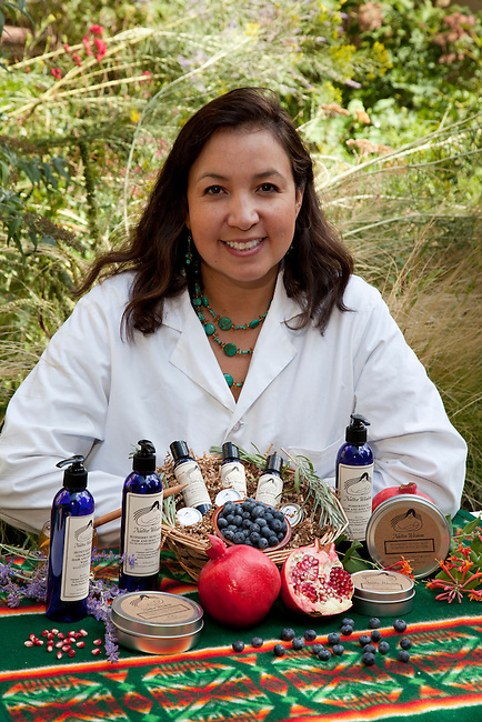 Native American woman, Jennifer Wolf (Ponca), dressed in lab technician coat, is an herbal research chemist works for the FDA (Food & Drug Administration) and develops products for Native Wisdom