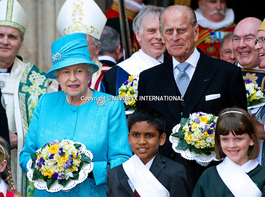 """THE QUEEN AND DUKE OF EDINBURGH.attended the Maundy Service at Westmister Abbey, London.The ocassion was also her 85th Birthday..During the Royal Maundy Service The Queen distributed the Maundy money to 85 women and 85 men - one for each of The Queen's 85 years_21/04/2011.Mandatory Photo Credit: ©Dias/Newspix International..**ALL FEES PAYABLE TO: """"NEWSPIX INTERNATIONAL""""**..PHOTO CREDIT MANDATORY!!: NEWSPIX INTERNATIONAL(Failure to credit will incur a surcharge of 100% of reproduction fees)..IMMEDIATE CONFIRMATION OF USAGE REQUIRED:.Newspix International, 31 Chinnery Hill, Bishop's Stortford, ENGLAND CM23 3PS.Tel:+441279 324672  ; Fax: +441279656877.Mobile:  0777568 1153.e-mail: info@newspixinternational.co.uk"""