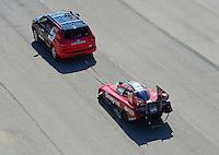Sept. 29, 2012; Madison, IL, USA: NHRA funny car driver Cruz Pedregon during qualifying for the Midwest Nationals at Gateway Motorsports Park. Mandatory Credit: Mark J. Rebilas-