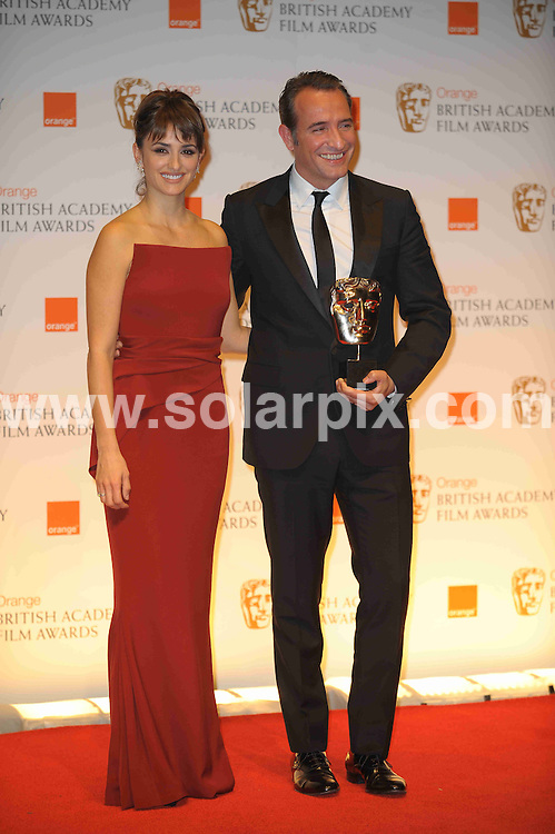 **ALL ROUND PICTURES FROM SOLARPIX.COM**                                             **WORLDWIDE SYNDICATION RIGHTS**                                                                                  Caption: Orange British Academy Film Awards at The .Royal Opera House in Covent Garden London                                                                              This pic:  Penelope Cruz; Jean Dujardin                                                                          JOB REF:14467        MSR       DATE: 12.02.2012                                                           **MUST CREDIT SOLARPIX.COM OR DOUBLE FEE WILL BE CHARGED**                                                                      **MUST AGREE FEE BEFORE ONLINE USAGE**                               **CALL US ON: +34 952 811 768 or LOW RATE FROM UK 0844 617 7637**