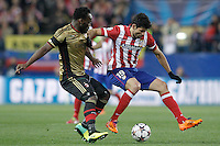 Atletico de Madrid's Diego Costa (r) and AC Milan's Michael Essien during Champions League 2013/2014 match.March 11,2014. (ALTERPHOTOS/Acero)