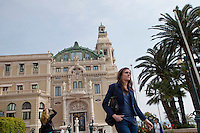 Stefanie A, a student of the International University of Monaco, walks down the Avenue de Monte Carlo in front of the Casino, Monte Carlo Monaco, 19 April 2013
