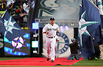 Seattle Mariners' Willie Bloomquist  runs towards his teammates after being introduced before their game against the Los Angeles Angels in the  season home opener April 6, 2015 at Safeco Field in Seattle.  The Mariners beat the Angels 4-1.     ©2015. Jim Bryant Photo. ALL RIGHTS RESERVED.