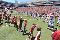 NWA Democrat-Gazette/Michael Woods --04/25/2015--w@NWAMICHAELW... Fans line up to greet the Razorbacks as they take the field to start the 2015 Red-White game Saturday afternoon at Razorback Stadium in Fayetteville.