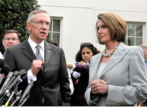 Washington, DC - October 6, 2009 -- United States Senate Majority Leader Harry Reid (Democrat of Nevada) makes remarks after meeting United States President Barack Obama on the U.S. strategy in Afghanistan on Tuesday, October 6, 2009.  At right is United States Speaker of the House Nancy Pelosi..Credit: Ron Sachs / Pool via CNP