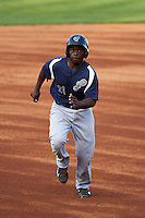 Pensacola Blue Wahoos first baseman Marquez Smith (21) running the bases during a game against the Mississippi Braves on May 28, 2015 at Trustmark Park in Pearl, Mississippi.  Mississippi  defeated Pensacola 4-2.  (Mike Janes/Four Seam Images)