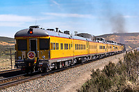 Union Pacific historical passenger cars trail behind the steam power of UP 844 and UP 4014 as they approach Evanston, Wyoming.