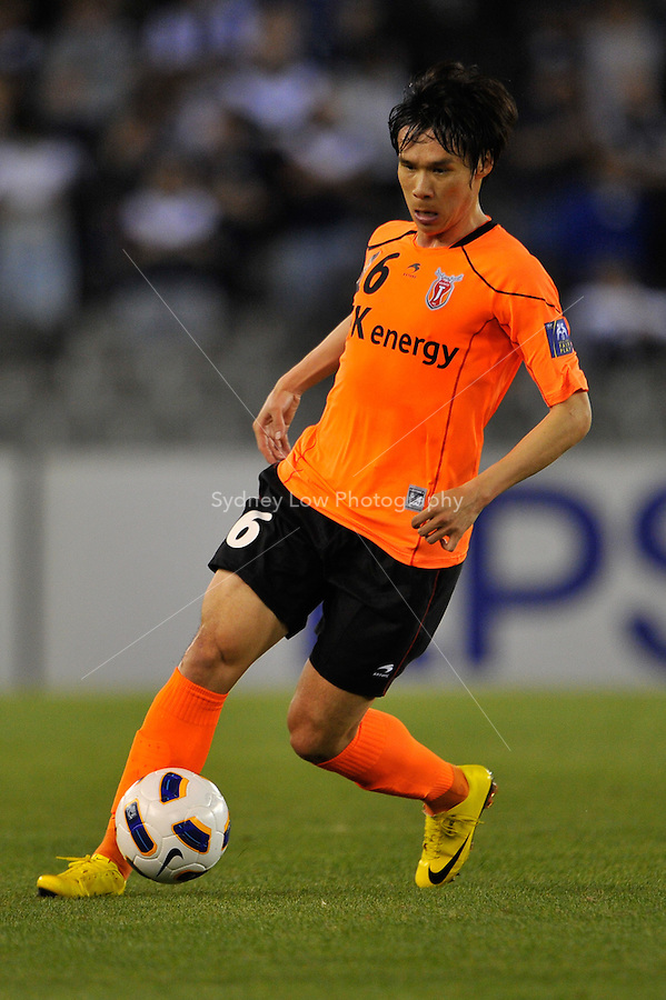 BAE KIJONG from Jeju United controls the ball during the AFC Champions League Group E match between the Melbourne Victory and Jeju United at Etihad Stadium in Melbourne, Australia.