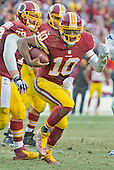 Washington Redskins quarterback Robert Griffin III (10) scrambles on a play that results in a touchdown in the fourth quarter against the Dallas Cowboys at FedEx Field in Landover, Maryland on Sunday, December 28, 2014.  The Cowboys won the game 44-17.<br /> Credit: Ron Sachs / CNP