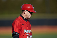 Gardner-Webb Runnin' Bulldogs head coach Rusty Stroupe coaches third base during the game against the Wake Forest Demon Deacons at David F. Couch Ballpark on February 18, 2018 in  Winston-Salem, North Carolina. The Demon Deacons defeated the Runnin' Bulldogs 8-4 in game one of a double-header.  (Brian Westerholt/Four Seam Images)