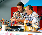 Jamie Oliver  and Gennaro Contaldo  cooking demo in The Big Kitchen at the big feastival  held at Alex James' farm near Kingham, Oxfordshire 01/09/2012