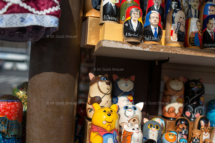 Souvenirs and matryoshkas with political figures, including Barack Obama, Vladimir Putin, Angela Merkel, Joseph Stalin, and Dmitrii Medvedev, are for sale in a souvenir market in Saint Petersburg, Russia.